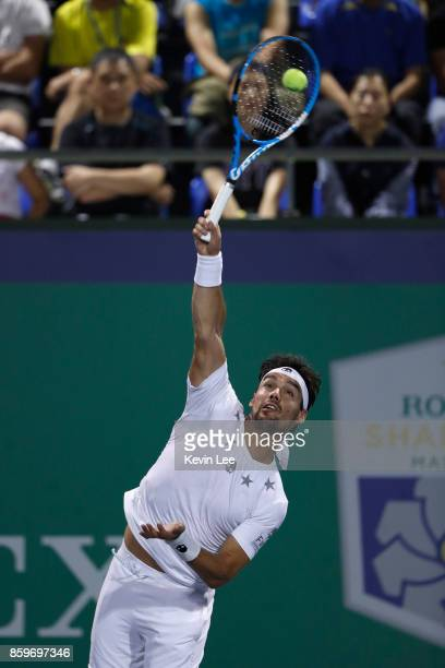 Fabio Fognini of Italy serves to Lucas Pouille of France in their match during Round 1 of Men's Single on Day 3 of 2017 ATP Shanghai Rolex Masters at...