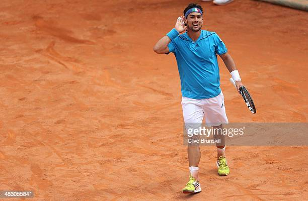 Fabio Fognini of Italy shakes celebrates match point after his straight sets victory against Andy Murray of Great Britain during day three of the...