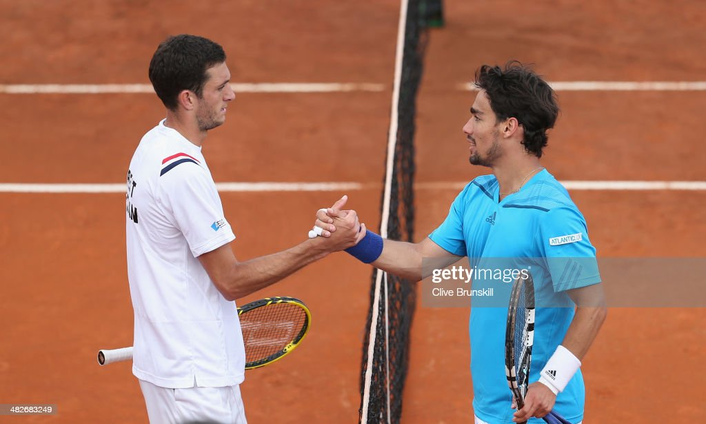 Fabio Fognini of Italy shakes hands at the net after his four set victory against James Ward of Great Britain during day one of the Davis Cup World Group Quarter Final match between Italy and Great Britain at Tennis Club Napoli on April 4, 2014 in Naples, Italy.