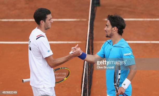 Fabio Fognini of Italy shakes hands at the net after his four set victory against James Ward of Great Britain during day one of the Davis Cup World...
