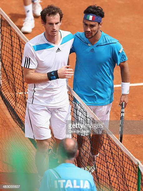 Fabio Fognini of Italy shakes hands at the net after his straight sets victory against Andy Murray of Great Britain during day three of the Davis Cup...