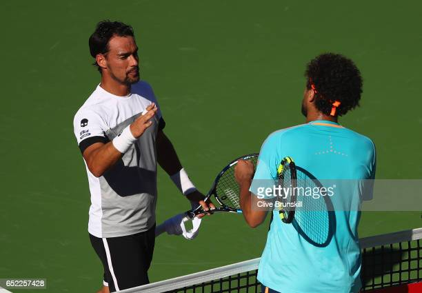 Fabio Fognini of Italy shakes hands at the net after his three set victory against JoWilfried Tsonga of France in their second round match during day...
