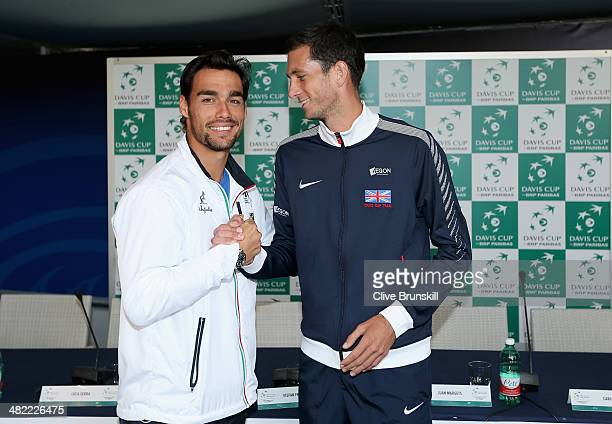 Fabio Fognini of Italy shakes hands with James Ward of Great Britain after the draw ceremony prior to them playing the opening rubber tomorrow at...