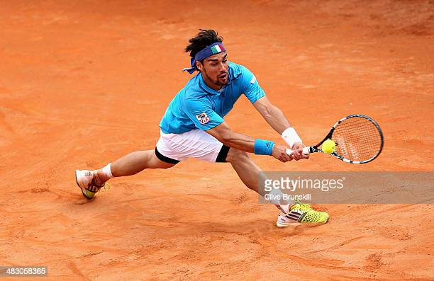 Fabio Fognini of Italy slides to play a backhand during his straight sets victory against Andy Murray of Great Britain during day three of the Davis...