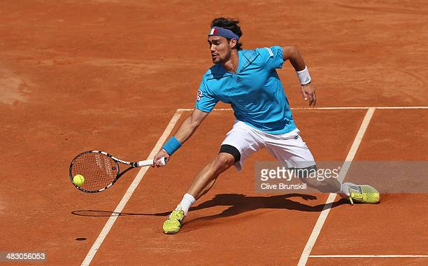 Fabio Fognini of Italy slides to play a forehand during his straight sets victory against Andy Murray of Great Britain during day three of the Davis...