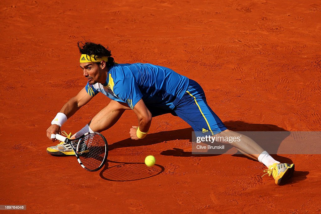 Fabio Fognini of Italy stretches to playa forehand in his Men's Singles match against Rafael Nadal of Spain during day seven of the French Open at Roland Garros on June 1, 2013 in Paris, France.