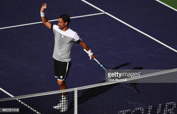 Fabio Fognini of Italy waves to the crowd after his three set victory against JoWilfried Tsonga of France in their second round match during day six...