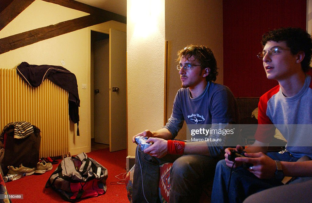 STRASBOURG, FRANCE - MAY 19. Fabio Folli, 19, (L) and Christian Ferrari, 18, Italian students from the Primo Levi Technical Institute of Vignola in the Modena Province, play a PlayStation vidoe game in their hotel room during a school trip to Strasbourg, France to visit the European Parliament May 19, 2004. School trips can be a sort of initiation trip for teenagers, where they are introduced for the first time to alcohol and drugs. Many times they don't sleep for the whole trip. The trips often allow the students to get to know each other better. If one is considered 'different' than the group, it can be a nightmare experience for the teenager. Mainly the teenagers are only interested in clubs, shopping and having a pizza instead of the cultural aspects of the school trip.