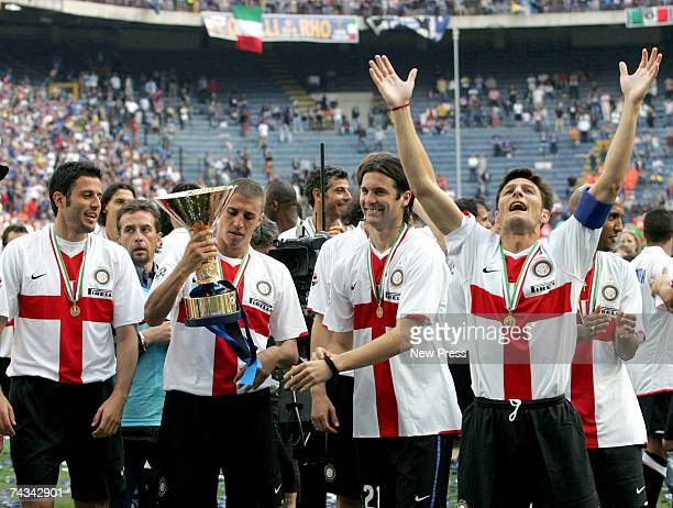 Fabio Grosso Hernan Crespo Santiago Solari and Javier Zannetti of Inter Milan celebrate with the Scudetto trophy after the Serie A match between...