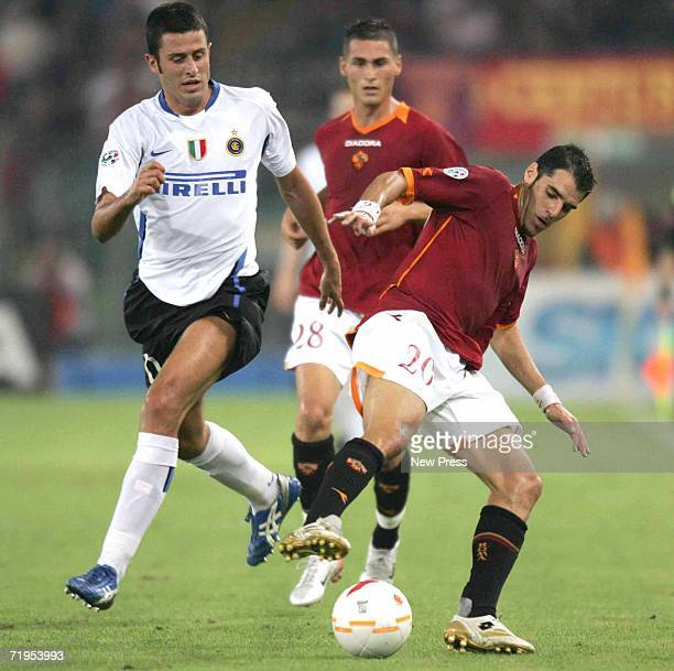 Fabio Grosso of Inter Milan defends as Simone Perrotta of Roma controls the ball during action at the Olympic Stadium September 20 2006 in Rome Italy...