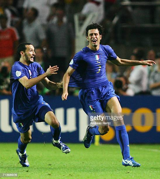 Fabio Grosso of Italy celebrates scoring his team's first goal in extra time during the FIFA World Cup Germany 2006 Semifinal match between Germany...