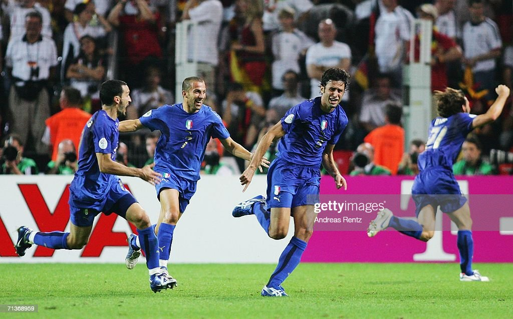 Fabio Grosso (R) of Italy celebrates scoring his team's first goal in extra time with team mates Gianluca Zambrotta (L) and Alessandro Del Piero during the FIFA World Cup Germany 2006 Semi-final match between Germany and Italy played at the Stadium Dortmund on July 04, 2006 in Dortmund, Germany.