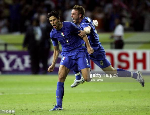 Fabio Grosso of Italy celebrates scoring the winning penalty in a penalty shootout with team mate Daniele De Rossi at the end of the FIFA World Cup...