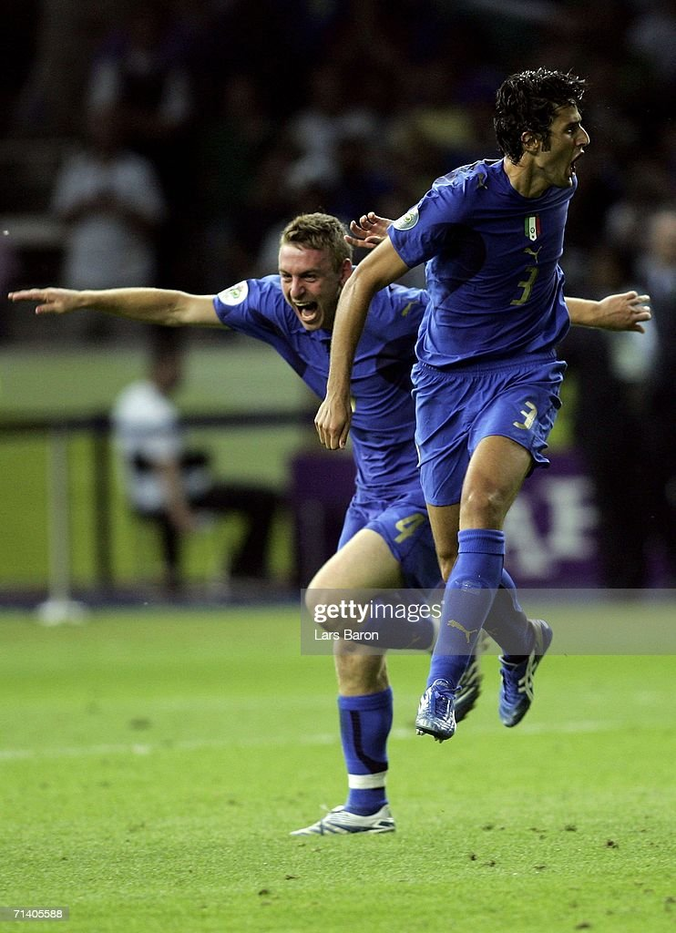 Fabio Grosso (R) of Italy celebrates scoring the winning penalty in a penalty shootout with team mate Daniele De Rossi at the end of the FIFA World Cup Germany 2006 Final match between Italy and France at the Olympic Stadium on July 9, 2006 in Berlin, Germany.
