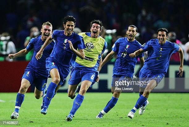 Fabio Grosso of Italy celebrates victory with his team mates after scoring the winning penalty in a penalty shootout at the end of the FIFA World Cup...
