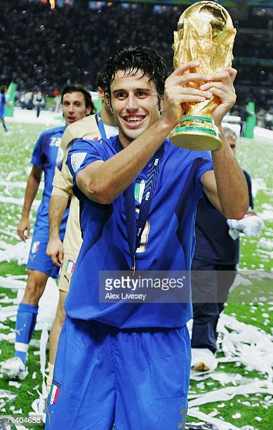 Fabio Grosso of Italy holds the World Cup trophy aloft following his team's victory in a penalty shootout at the end of the FIFA World Cup Germany...
