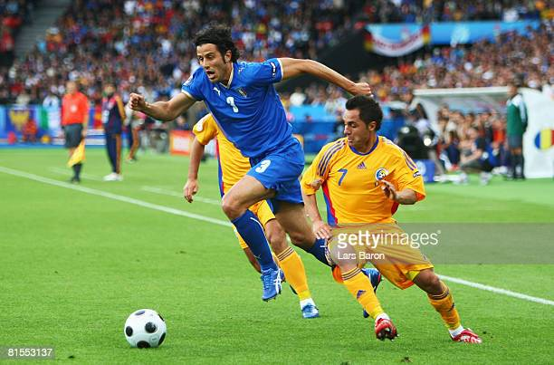 Fabio Grosso of Italy is chased by Florentin Petre of Romania during the UEFA EURO 2008 Group C match between Italy and Romania at Letzigrund Stadion...