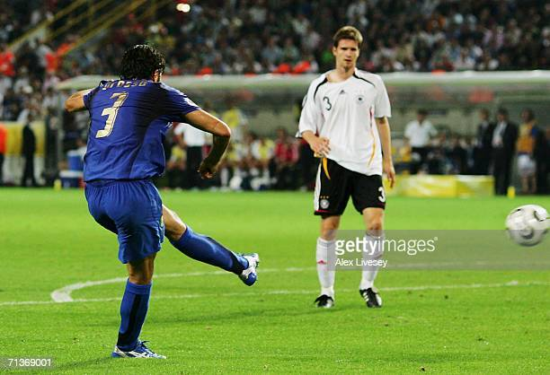 Fabio Grosso of Italy scores his team's first goal in extra time during the FIFA World Cup Germany 2006 Semifinal match between Germany and Italy...
