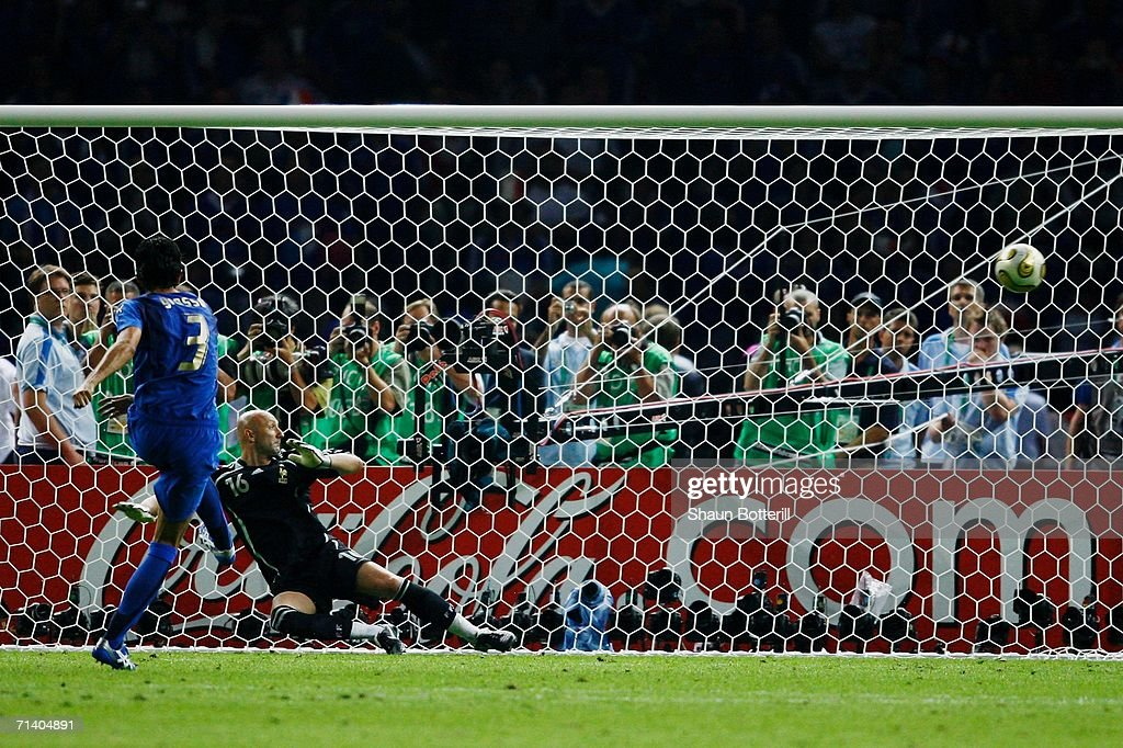 Fabio Grosso of Italy scores the winning penalty in a penalty shootout at the end of the FIFA World Cup Germany 2006 Final match between Italy and France at the Olympic Stadium on July 9, 2006 in Berlin, Germany.