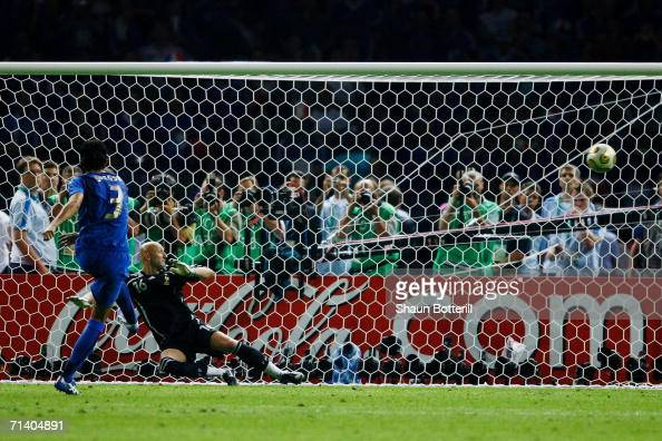 Fabio Grosso of Italy scores the winning penalty in a penalty shootout at the end of the FIFA World Cup Germany 2006 Final match between Italy and...