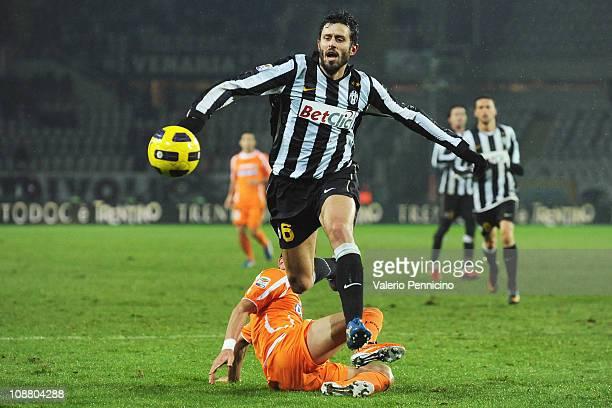 Fabio Grosso of Juventus FC in action against Mauricio Isla of Udinese Calcio during the Serie A match between Juventus FC and Udinese Calcio at...