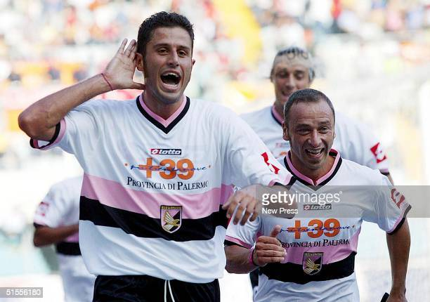 Fabio Grosso of Palermo celebrates scoring during the Seria A match between Roma and Palermo at the Stadio Olimpico on October 24 2004 in Rome Italy