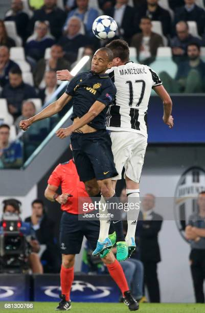 Fabio Henrique Tavares aka Fabinho of Monaco Mario Mandzukic of Juventus during the UEFA Champions League semi final second leg match between...