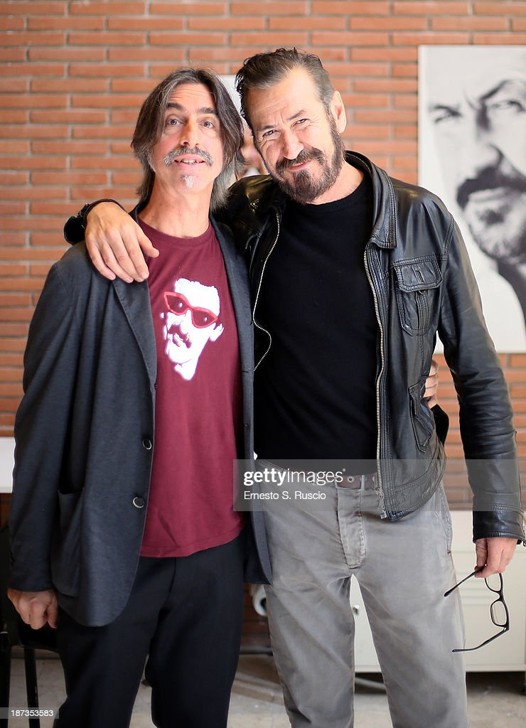 Fabio Lovino (L) and Marco Giallini attend the Fabio Lovino Exhibition Opening during the 8th Rome Film Festival at the Auditorium Parco Della Musica on November 8, 2013 in Rome, Italy.