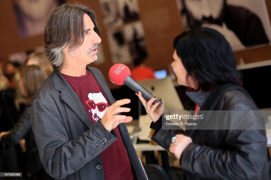 Fabio Lovino is interviewed at the Fabio Lovino Exhibition Opening during the 8th Rome Film Festival at the Auditorium Parco Della Musica on November 8, 2013 in Rome, Italy.