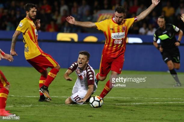 Fabio Lucioni of Benevento vies Ljajic Adem of Torino FC during the Serie A match between Benevento Calcio and Torino FC at Stadio Ciro Vigorito on...