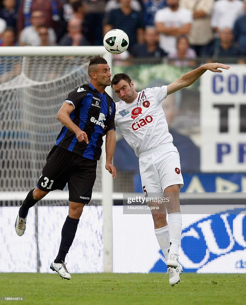 Fabio Lucioni (R) of Reggina competes for the ball in air with Abdelkader Ghezzal of Latina during the Serie B match between US Latina and Reggina Calcio at Stadio Domenico Francioni on November 1, 2013 in Latina, Italy.