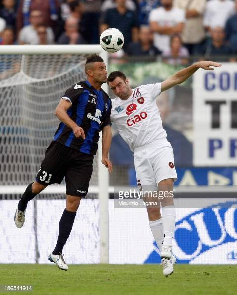 Fabio Lucioni of Reggina competes for the ball in air with Abdelkader Ghezzal of Latina during the Serie B match between US Latina and Reggina Calcio...