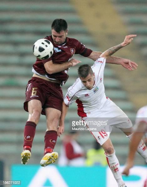 Fabio Lucioni of Reggina competes for the ball in air with Francesco Fedato of Bari during the Serie B match between AS Bari and Reggina Calcio at...