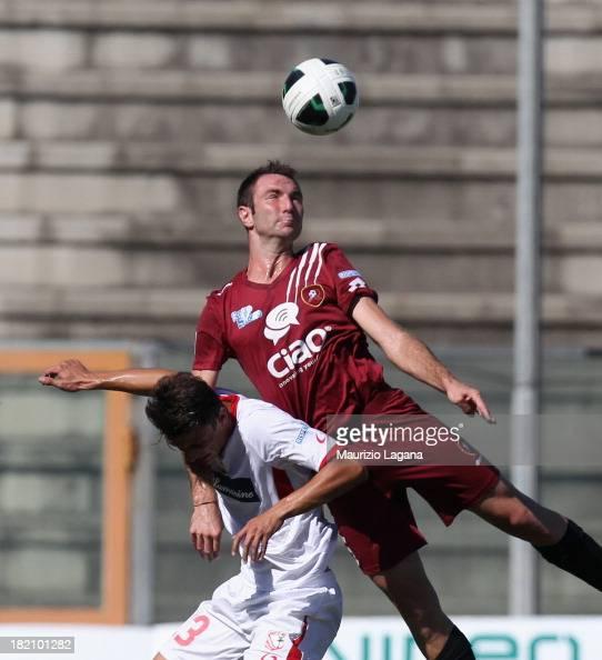 Fabio Lucioni of Reggina competes for the ball in air with Gaetano Letizia of Carpi during the Serie B match between Reggina Calcio and of Carpi FC...