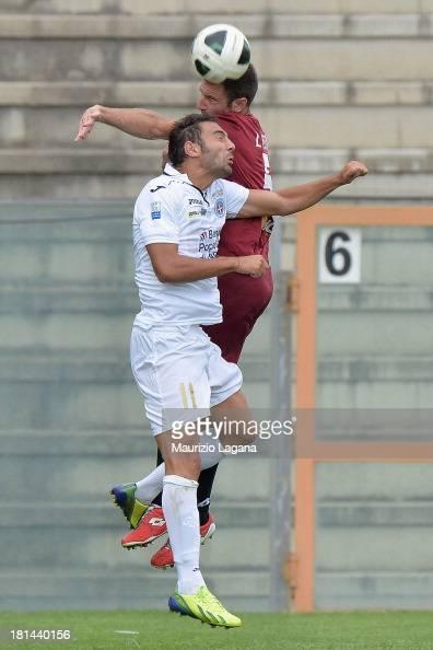 Fabio Lucioni of Reggina competes for the ball in air with Gianmario Comi of Novara during the Serie B match between Reggina Calcio and Novara Calcio...