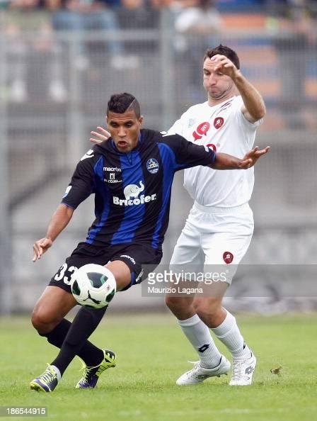 Fabio Lucioni of Reggina competes for the ball with Jonathas of Latina during the Serie B match between US Latina and Reggina Calcio at Stadio...