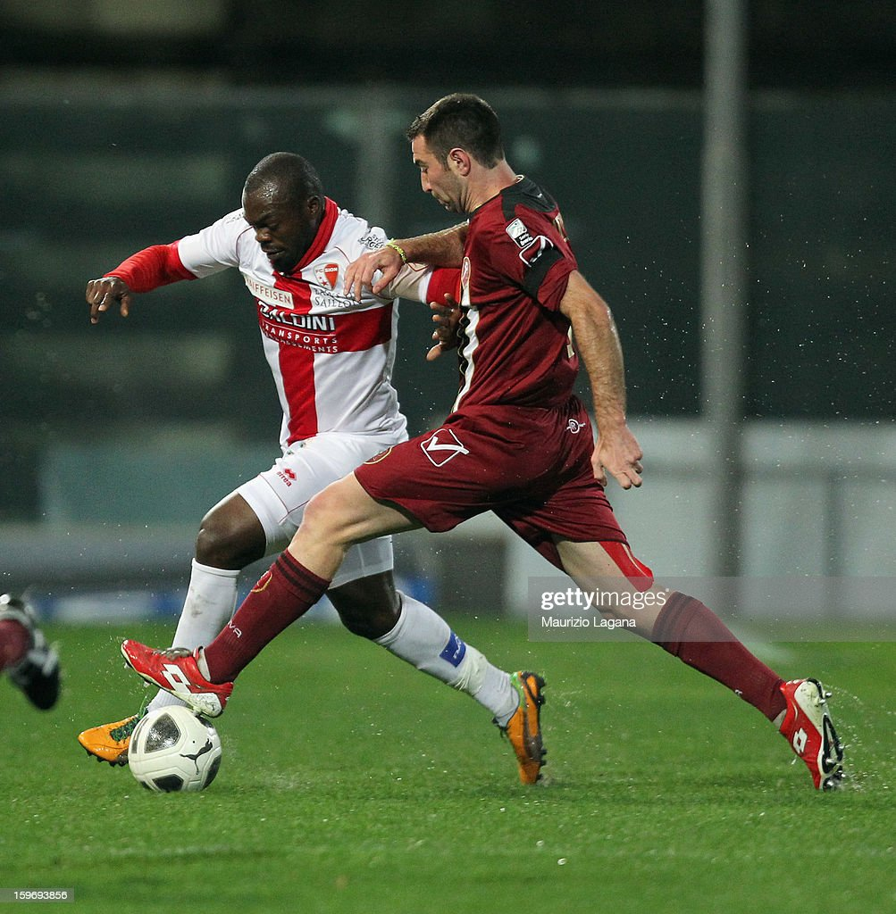 Fabio Lucioni (R) of Reggina competes for the ball with Yannick Ndjeng of Sion during the friendly match between Reggina Calcio and FC Sion on January 18, 2013 in Reggio Calabria, Italy.