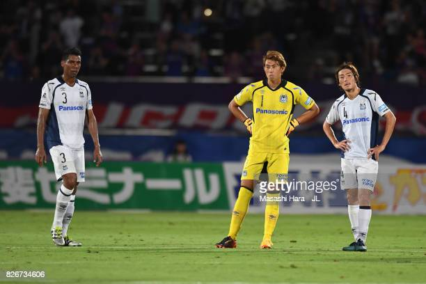 Fabio Masaaki Higashiguchi and Hiroki Fujiharu of Gamba Osaka show dejection after 01 defeat in the JLeague J1 match between Ventforet Kofu and Gamba...