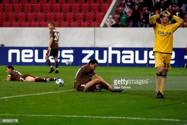 Fabio Morena Matthias Lehmann Ralph Gunesch and goalkeeper Mathias Hain of St Pauli react after an own goal by Morena during the Second Bundesliga...
