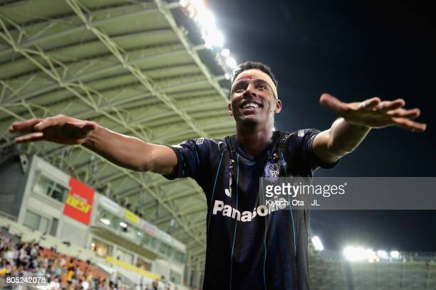 Fabio of Gamba Osaka celebrates his side's 32 victory with supporters after the JLeague J1 match between Vegalta Sendai and Gamba Osaka at Yurtec...