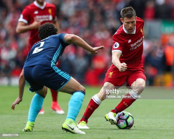 Fabio of Middlesbrough and James Milner of Liverpool during the Premier League match between Liverpool and Middlesbrough at Anfield on May 21 2017 in...
