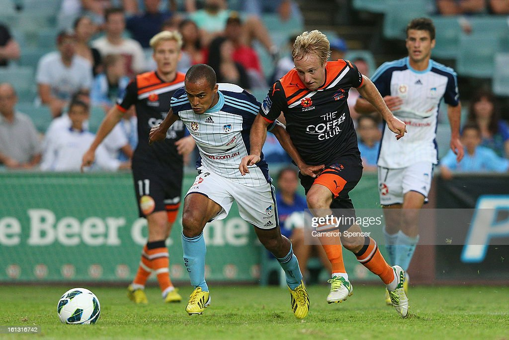 Fabio of Sydney FC and Mitchell Nichols of Roar contest the ball during the round 20 A-League match between Sydney FC and the Brisbane Roar at Allianz Stadium on February 10, 2013 in Sydney, Australia.