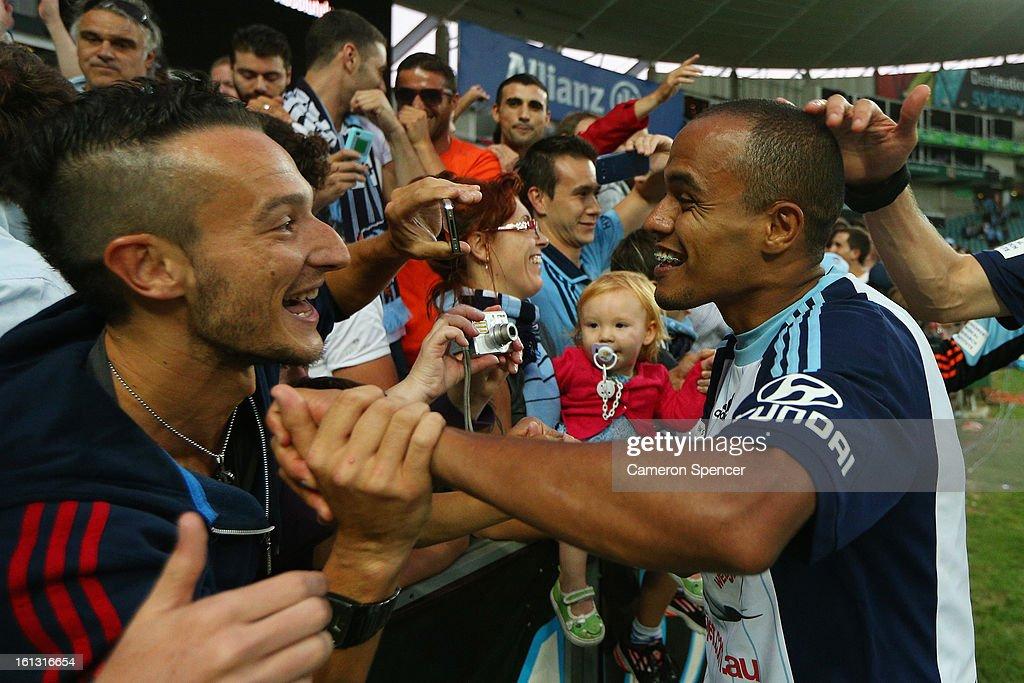 Fabio of Sydney FC celebrates with Sydney FC fans after winning the round 20 A-League match between Sydney FC and the Brisbane Roar at Allianz Stadium on February 10, 2013 in Sydney, Australia.