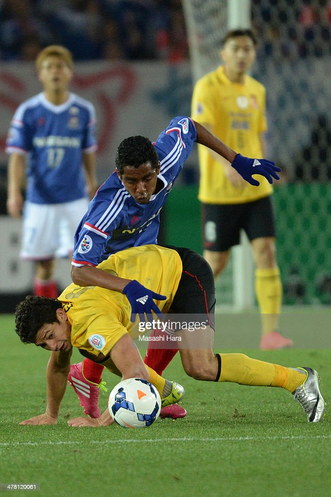 Fabio #15 of Yokohama F.Marinos and Kim Elkeson #9 of Guangzhou Evergrande (under) compete for the ball during the AFC Champions League Group G match between Yokohama F.Marinos and Guangzhou Evergrande at Nissan Stadium on March 12, 2014 in Yokohama, Japan.