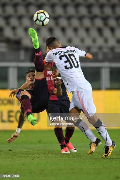 Fabio Pisacane of Cagliari Calcio is tackled by Ilja Nestorovski of US Citta di Palermo during the TIM Cup match between Cagliari Calcio and US Citta...