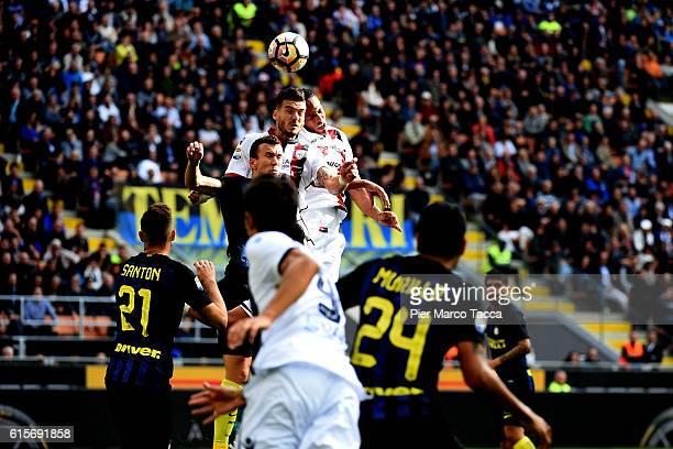 Fabio Piscane and Bruno Alves of Cagliari Calcio hit the ball with the head during the Serie A match between FC Internazionale and Cagliari Calcio at...