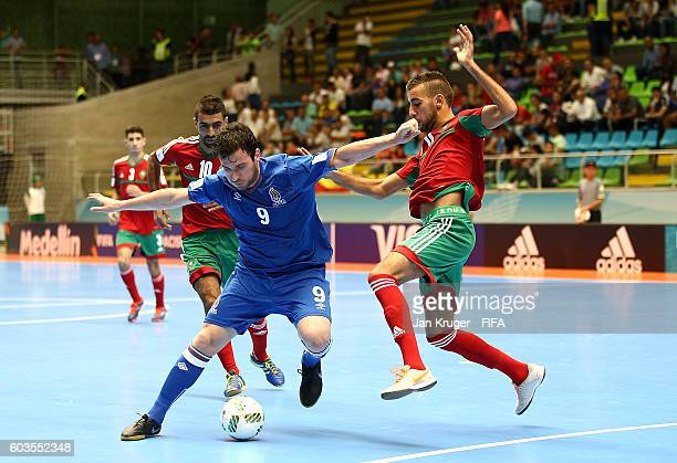 Fabio Poletto of Azerbaijan holds off Bilal Bakkali of Morocco during the FIFA Futsal World Cup Group F match between Morocco and Azerbaijan at...