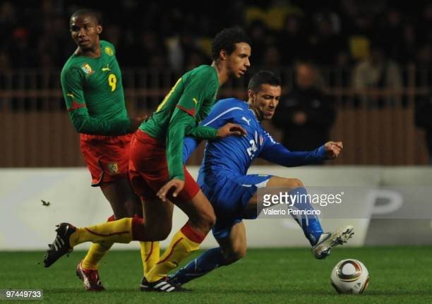 Fabio Quagliarella of Italy battles for the ball with Joel Matip of Cameroon during the International Friendly match between Italy and Cameroon at...