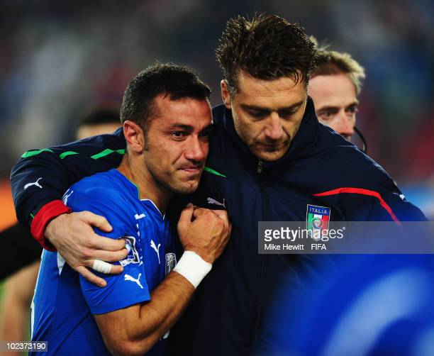 Fabio Quagliarella of Italy is consoled after the 2010 FIFA World Cup South Africa Group F match between Slovakia and Italy at Ellis Park Stadium on...