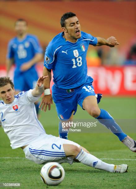 Fabio Quagliarella of Italy tackled by Peter Pekarik of Slovakia during the 2010 FIFA World Cup South Africa Group F match between Slovakia and Italy...